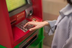 Close-up of woman hand entering PIN/pass code on ATM/bank machine keypad. Close-up of woman hand entering PIN/pass code on ATM/bank machine keypad and getting royalty free stock photos