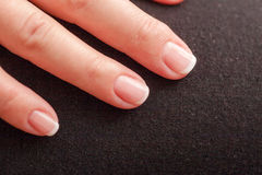 Close-up of woman hand with french manicure Stock Images