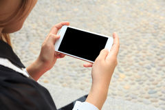 Close-up Of A Woman Hand Holding Cellphone Watching Video Stock Images