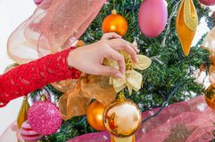 Close up of woman hand holding a christmas ball decorating a christmas tree, merry christmast and happy new year concept.  Royalty Free Stock Photos