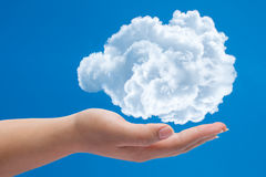 Close up of woman hand holding cloud with copy. Cloud computing concept Stock Images