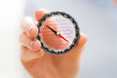 Close up of woman hand holding compass Royalty Free Stock Photos