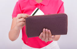 Close up of woman hand holding credit card in amoney wallet Royalty Free Stock Photography