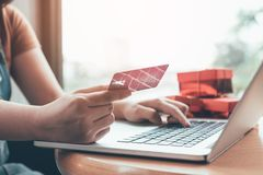 Close up woman hand holding credit card and typing laptop keyboard with shopping online concept. royalty free stock photos