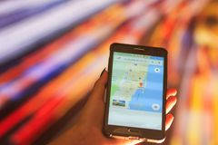 Map of Florida on the phone in the background of a night city. Close Up Of Woman Hand Holding Mobile Phone. Close Up Of Woman Hand Holding Mobile Phone. map of royalty free stock photography