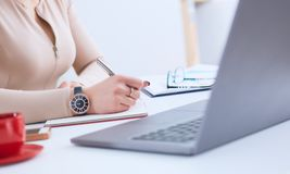 Close-up of a woman hand holding pen and signing papers. Selective focus. royalty free stock images