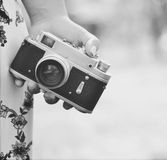 Close up of woman hand holding retro camera Royalty Free Stock Image