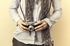 Close up of woman hand holding retro camera Stock Photo