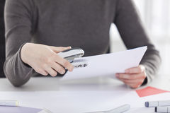Close up of woman hand holding stapler Stock Photography