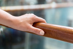 Close up of woman hand holding to railing Stock Photography