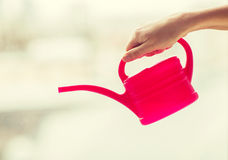 Close up of woman hand holding watering can Stock Photos
