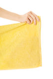 Close up on woman hand holding yellow towel Stock Photo