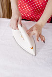Close up of woman hand ironing Stock Images