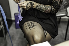 Close up woman hand with latex glove, tattooing Royalty Free Stock Photos