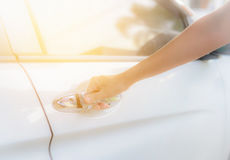 Close up woman hand opening white car door Royalty Free Stock Photo