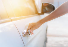 Close up woman hand opening white car door Royalty Free Stock Image