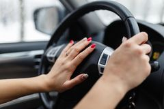 Close up of woman hand pressing the horn button while driving a royalty free stock photography