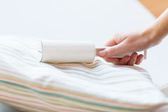 Close up of woman hand with sticky roller cleaning Stock Photography