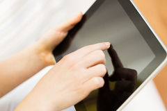 Close up of woman hand with tablet pc at home Stock Photos