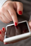 Close up of a woman hand using a smart phone Royalty Free Stock Image