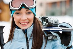 Close up of woman handing skis Royalty Free Stock Photography