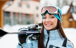 Close up of woman handing skis who thumbs up stock image