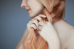 Close up woman hands braiding hair, sensual look. Studio portrait beauty Royalty Free Stock Photos
