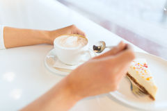 Close up of woman hands with cake and coffee Stock Photography