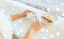 Close up of woman hands with cake and coffee Royalty Free Stock Photography