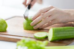 Close up of woman hands chopping green vegetables Royalty Free Stock Photo