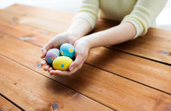 Close up of woman hands with colored easter eggs Stock Photos