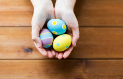 Close up of woman hands with colored easter eggs Royalty Free Stock Images