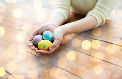 Close up of woman hands with colored easter eggs Royalty Free Stock Photo