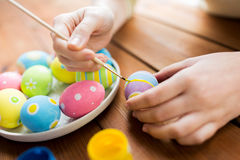 Close up of woman hands coloring easter eggs Stock Image
