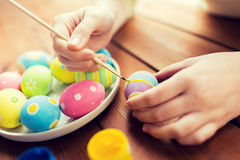 Close up of woman hands coloring easter eggs Royalty Free Stock Photo