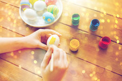 Close up of woman hands coloring easter eggs Stock Photography