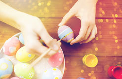 Close up of woman hands coloring easter eggs Royalty Free Stock Photography
