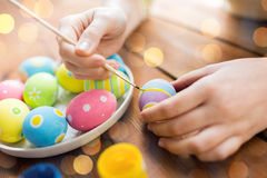 Close up of woman hands coloring easter eggs Royalty Free Stock Image