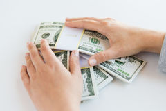 Close up of woman hands counting us dollar money. Business, finance, saving, banking and people concept - close up of woman hands counting us dollar money Stock Image
