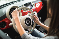 Close up of woman hands driving a car. Close up of woman hands driving a small car Stock Images