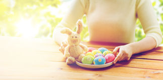 Close up of woman hands with easter eggs and bunny Stock Image