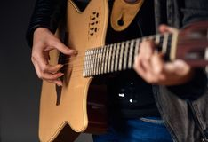 Close-up of woman hands with guitar Stock Photo