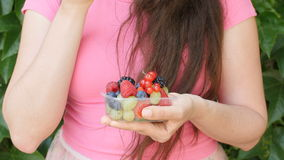 Close up of woman hands holding berries and fruits mix stock video footage