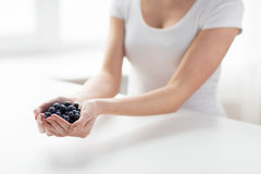 Close up of woman hands holding blueberries Stock Image