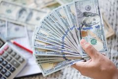 Close up woman hands holding and counting bunch of America dollars stock photography