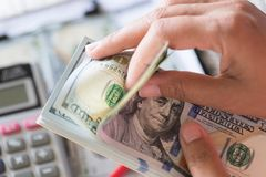 Close up woman hands holding and counting bunch of America dollars stock image