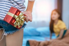 Close up of woman hands holding gift for surprise her girlfriend royalty free stock photo