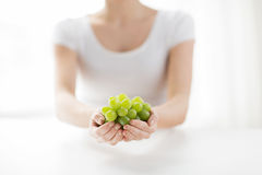 Close up of woman hands holding green grape bunch Stock Images