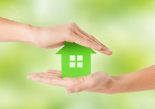 Close up of woman hands holding green house Stock Image