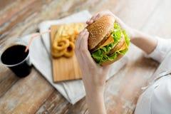 Close up of woman hands holding hamburger Stock Photo